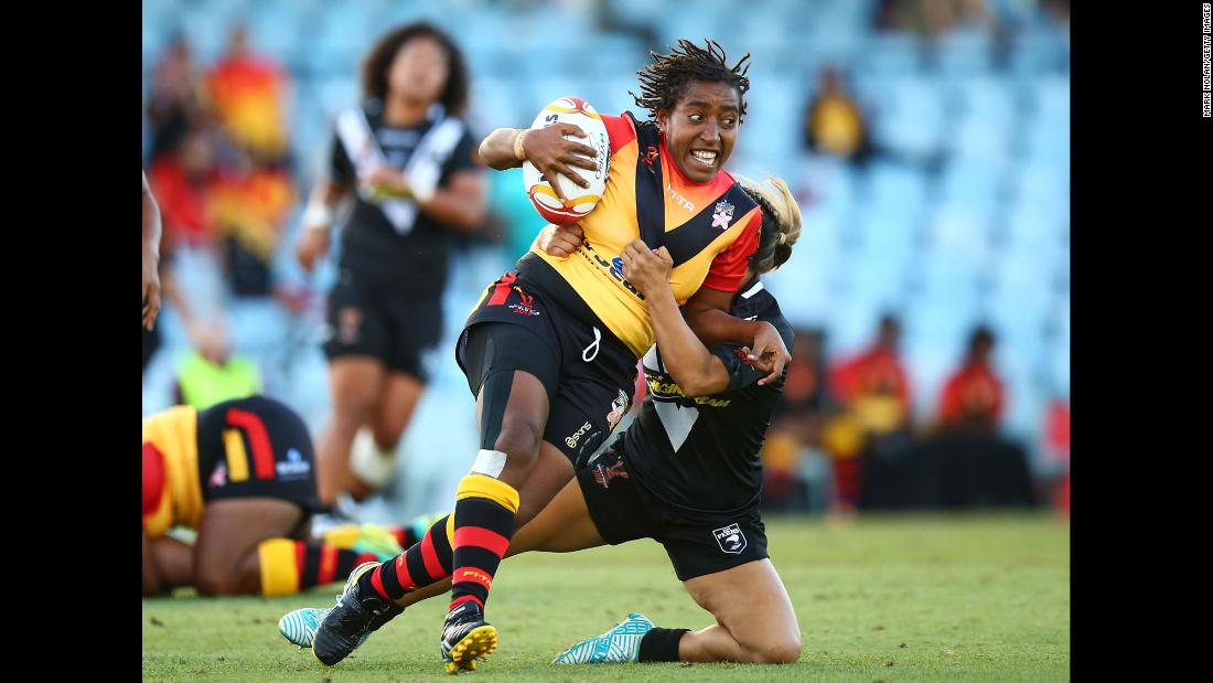 Papua New Guinea's Della Audama is tackled during a Rugby League World Cup match against New Zealand on Wednesday, November 22.