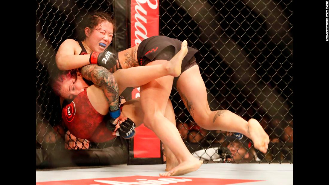 Gina Mazany takes down Wu Yanan during a UFC fight in Shanghai, China, on Saturday, November 25. Mazany won by unanimous decision.