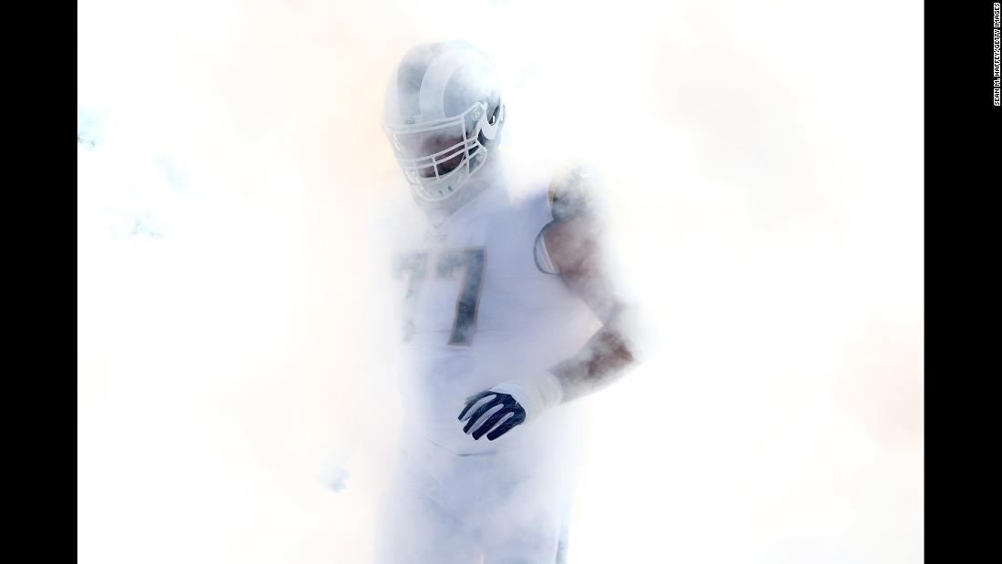 Smoke envelops Los Angeles Rams tackle Andrew Whitworth before an NFL game against New Orleans on Sunday, November 26.