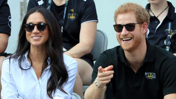 Harry watches wheelchair tennis with his girlfriend, Meghan Markle, at the Invictus Games in September.