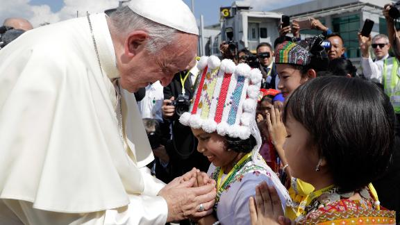 Pope Francis is welcomed by children on November 27.