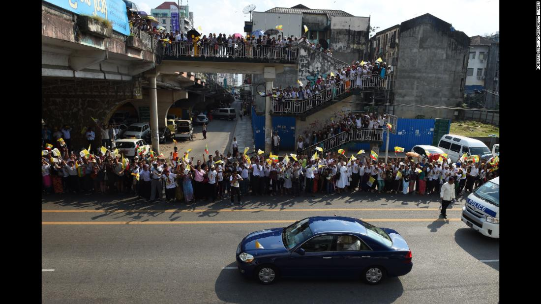 Crowds welcome Pope Francis' motorcade as it passes through Yangon on Monday, November 27.