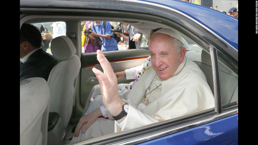 Pope Francis waves to admirers upon arrival at Yangon International Airport.