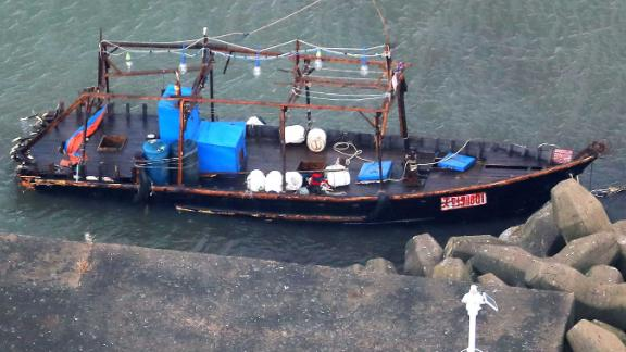 A wooden boat is moored at a nearby marina, in Yurihonjo, Akita prefecture, northern Japan, Friday, Nov. 24, 2017.   Japanese police are investigating eight men found on Japan