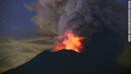 A general view shows Mount Agung erupting seen at night from Kubu sub-district in Karangasem Regency on Indonesia's resort island of Bali on November 28, 2017. 