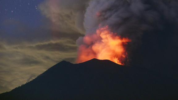 A general view shows Mount Agung erupting seen at night from Kubu sub-district in Karangasem Regency on Indonesia's resort island of Bali on November 28, 2017. Indonesian authorities extended the closure of the international airport on the resort island of Bali for a second day over fears of a volcanic eruption. / AFP PHOTO / SONNY TUMBELAKA        (Photo credit should read SONNY TUMBELAKA/AFP/Getty Images)