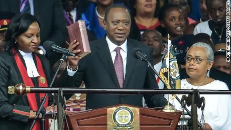 Kenya's President Uhuru Kenyatta takes oath of office during his inauguration ceremony at Kasarani Stadium on November 28, 2017 in Nairobi.
