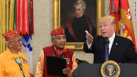 President Donald Trump, right, speaks during a meeting with Navajo Code Talkers including Fleming Begaye Sr., seated left, Thomas Begay, second from left, and Peter MacDonald, second from right, in the Oval Office of the White House in Washington, Monday, Nov. 27, 2017. (AP Photo/Susan Walsh)
