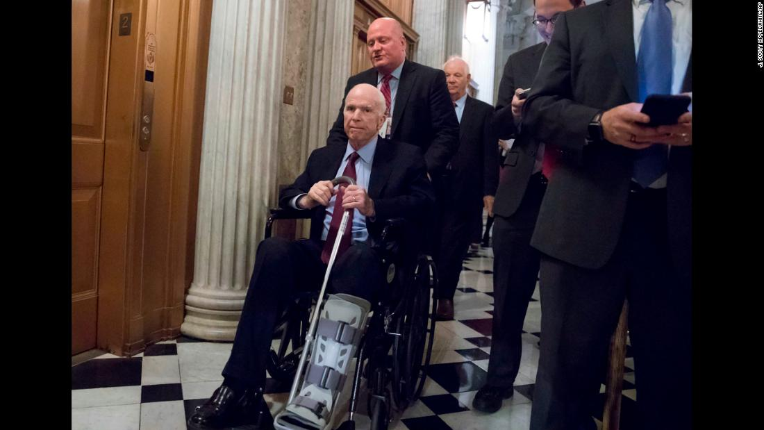 McCain arrives for votes on Capitol Hill in November 2017. He suffered an Achilles tendon tear on his right side and had to wear a walking boot. In this photo, he's wearing the boot on his other leg. He said on Twitter that it was to give a break to his left leg, which was tired from compensating for his injury.