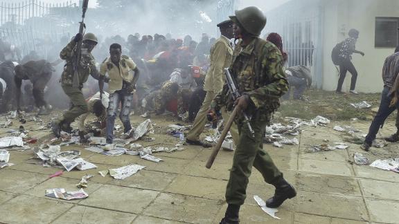 Police intervene during a stampede in Nairobi as supporters of Kenya