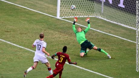FORTALEZA, BRAZIL - JUNE 21:  Asamoah Gyan of Ghana scores his team's second goal past Manuel Neuer of Germany during the 2014 FIFA World Cup Brazil Group G match between Germany and Ghana at Castelao on June 21, 2014 in Fortaleza, Brazil.  (Photo by Jamie McDonald/Getty Images)
