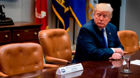 US President Donald Trump looks at the empty chair of Senate Minority Leader Chuck Schumer (L), D-New York, after Schumer cancelled their meeting at the White House in Washington, DC, on November 28, 2017. (JIM WATSON/AFP/Getty Images)