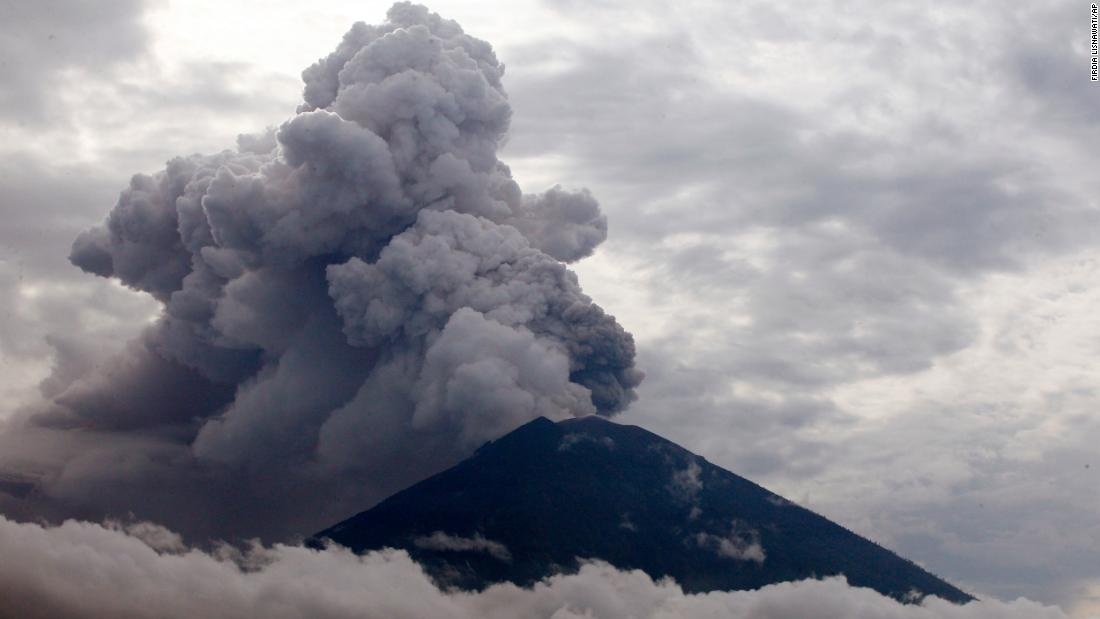 Clouds of ashes rise from the Mount Agung volcano erupting in Karangasem, Bali, Indonesia, Tuesday, November 28. The  volcano erupted for the first time in more than half a century, forcing closure of the Indonesian tourist island's busy airport and forcing tens of thousands from their homes.