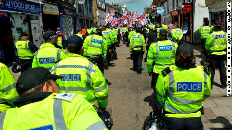 Police officers monitor a Britain First protest march in Luton, England, in June 2015.