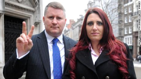 Britain First leader Paul Golding and deputy leader Jayda Fransen arrive at the Royal Courts of Justice in central London.