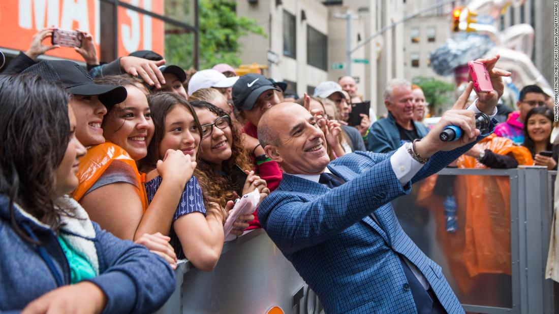 Lauer takes a selfie photo with fans on May 31.