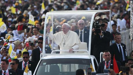 Pope Francis waves to Myanmar catholic well wishers as he arrives for an open air mass in Yangon on November 29, 2017.