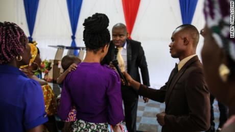 "Pastor Etinosa Osiomwanhi interacts with his congregation during a Sunday service. He denies that Sandra's trafficker was an assistant pastor at his church. ""You know pastors do certain things,"" he said. ""I don't call them pastors, I call them herbalists or native doctors in suits who would do such."""