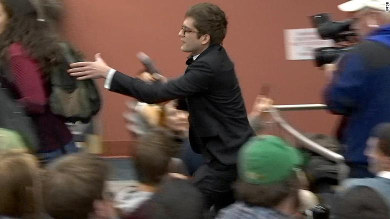 See right-wing speaker scuffle with crowd