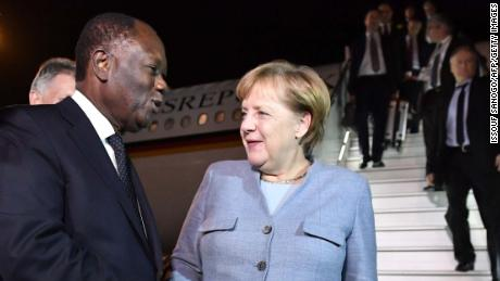 Ivorian president Alassane Ouattara welcomes German Chancellor Angela Merkel as she arrives in Abidjan for the summit.