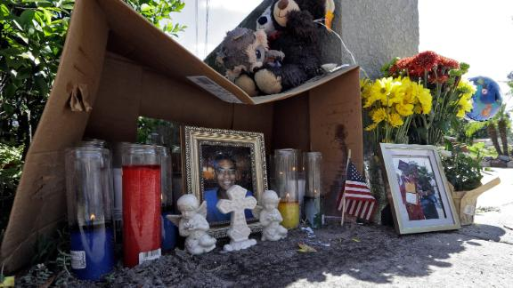 A makeshift memorial for shooting victim Anthony Naiboa sits on a sidewalk in the Seminole Heights neighborhood of Tampa on October  24.