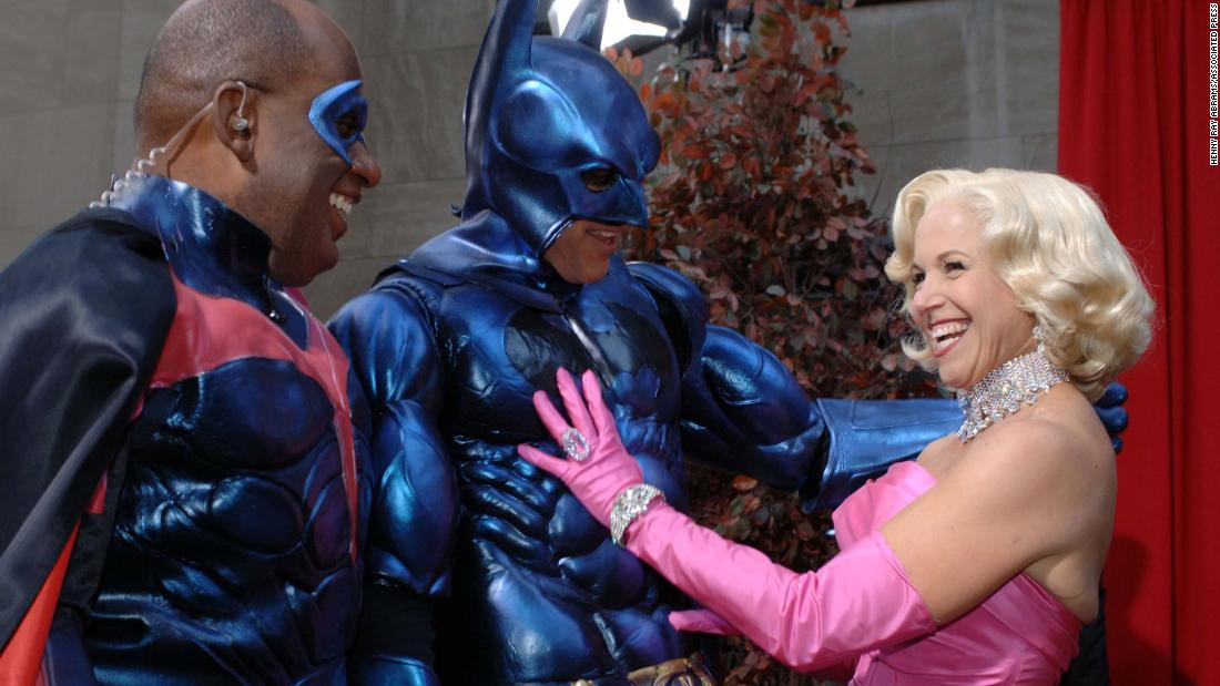 Hosts Al Roker, left, Lauer, and Couric admire each others' costumes during the show's annual Halloween segment in 2005.