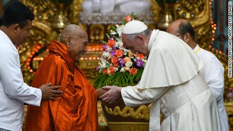 Pope Francis (R) attends a meeting with Bhaddanta Kumarabhivasma (L), Chairman of state Sanga Maha Nayaka Committee, in Yangon on November 29, 2017.