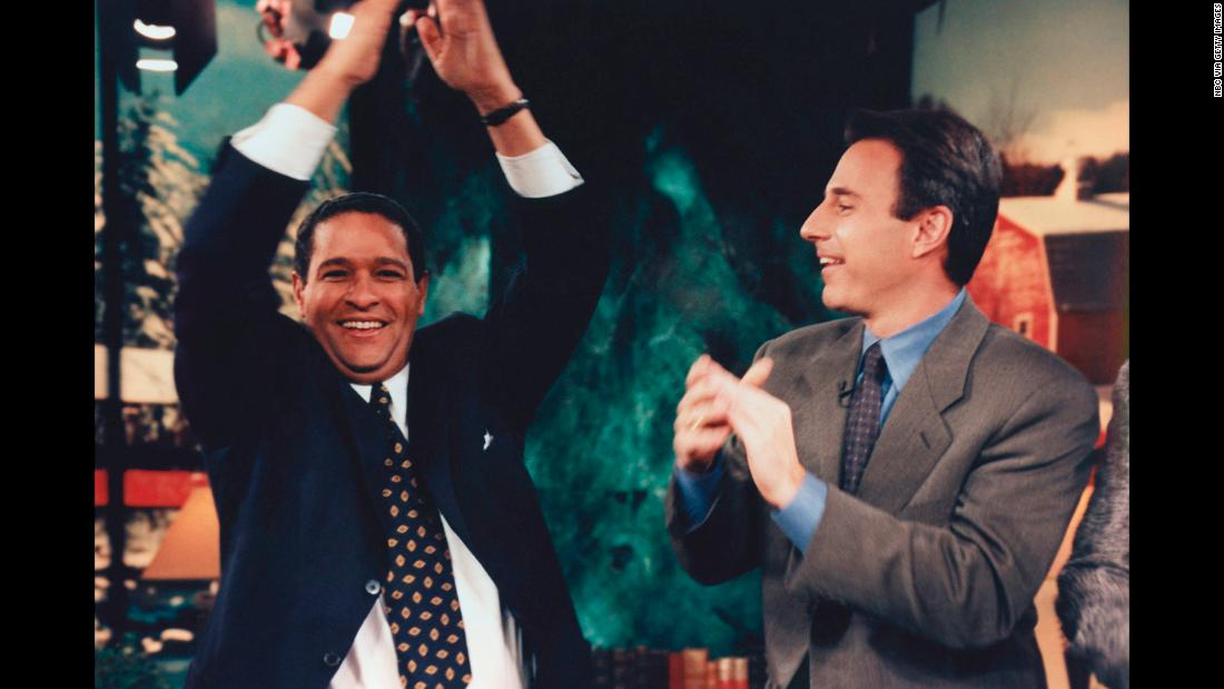 "Hosts Bryant Gumbel and Lauer cheer together during Gumbel's last appearance on the ""Today"" show in 1997."