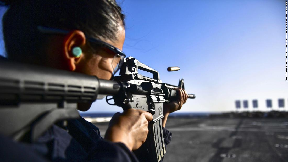 Seaman Joanna Valdez, on the flight deck of the USS San Diego in the Mediterranean Sea, fires a rifle during a live-fire training exercise on Wednesday, November 8.