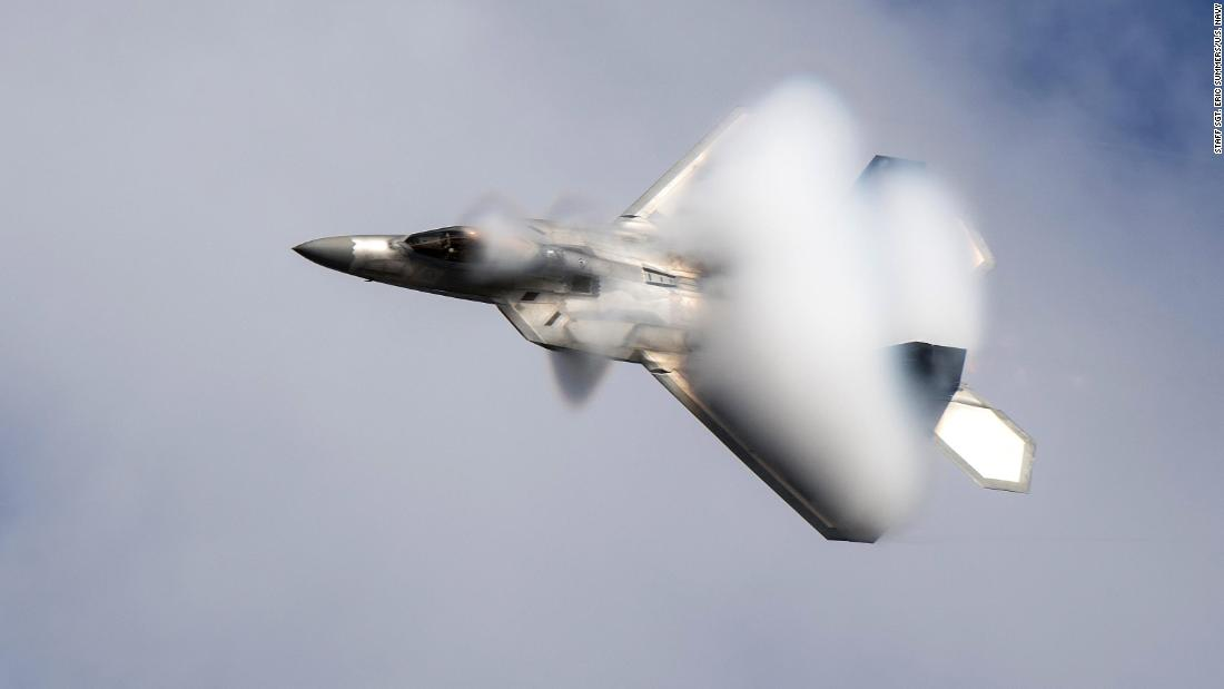 An Air Force pilot demonstrates the capabilities of an F-22 Raptor during an event in Jacksonville, Florida, on Sunday, November 19.