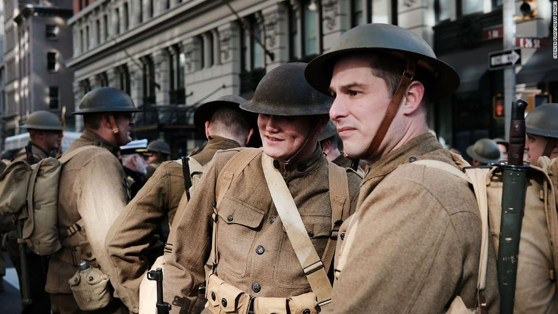 Men wear World War I replica uniforms as they wait to march in the Veterans Day Parade in New York City on Saturday, November 11.