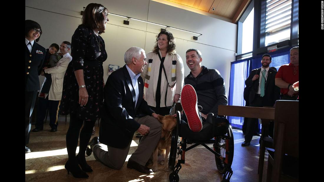 Vice President Mike Pence and his wife, Karen, greet Marine Corps veteran Liam Dwyer and his wife, Meghan, at the USO Warrior and Family Center in Bethesda, Maryland, on Wednesday, November 22.