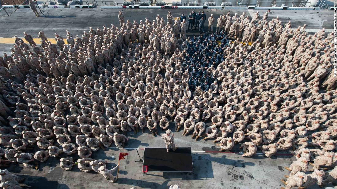 Lt. Gen. William D. Beydler, commander of the US Marine Forces Central Command, speaks to Marines and sailors on the flight deck of the USS America during the ship's scheduled port visit to Jebel Ali, United Arab Emirates, on Friday, November 10.