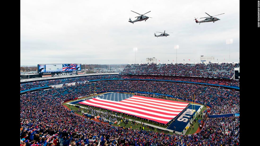 Navy helicopters fly over New Era Field in Orchard Park, New York, before an NFL game on Sunday, November 12. The Salute to Service ceremony took place before the game between the Buffalo Bills and New Orleans Saints.