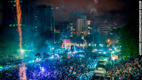Thousands of Gremio fans line the streets of Porto Alegre to celebrate their team's Copa Libertadores win.