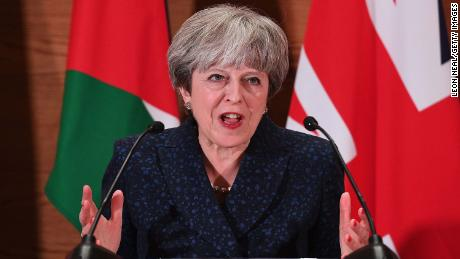 Theresa May addresses guests and media during a speech in Amman, Jordan
