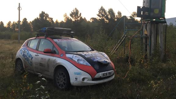 The Ramseys' car hooked to an electricity pylon in Siberia.