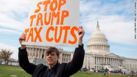 Demonstrators protest against the Republican tax reform plan during a rally organized by Our Revolution and Americans for Tax Fairness Action Fund on Capitol Hill in Washington, DC, November 15, 2017.