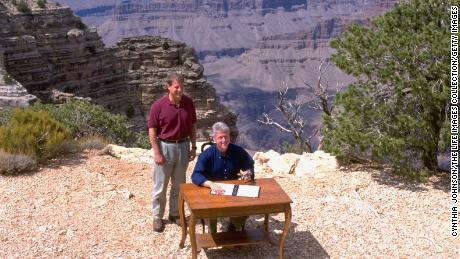President Bill Clinton and Vice President Al Gore pose at the edge of the Grand Canyon, during the signing of a proclamation establishing Utah's Grand Staircase-Escalante National Monument.