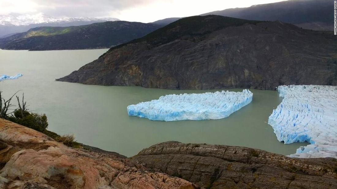 "An iceberg breaks off from the Grey Glacier in Punta Arenas, Chile, on Tuesday, November 28. Park officials said such detachments are rare and haven't occurred since the early '90s, <a href=""https://www.theguardian.com/environment/2017/nov/29/large-iceberg-breaks-off-from-grey-glacier-in-southern-chile"" target=""_blank"">according to The Guardian.</a>"