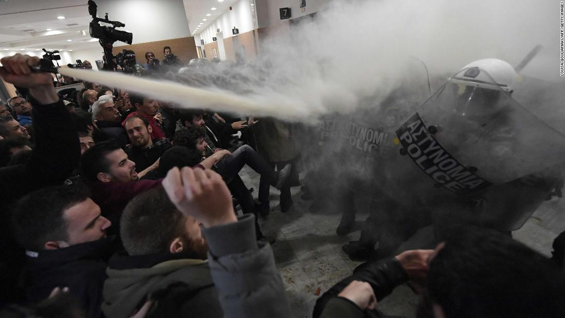 Demonstrators clash with police in the lobby of a courtroom in Athens, Greece, on Wednesday, November 29. The demonstrators were protesting the auctions of foreclosed homes.