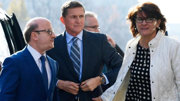 Former Trump national security adviser Michael Flynn, center, arrives at federal court in Washington, Friday, Dec. 1, 2017. Court documents show Flynn, an early and vocal supporter on the campaign trail of President Donald Trump whose business dealings and foreign interactions made him a central focus of Mueller