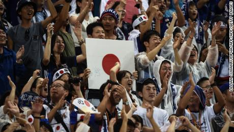 Japanese fans rejoice after Genki Haraguchi scored the first goal in Japan's 2-0 victory over Thailand during the 2018 FIFA World Cup qualifying football match between Thailand and Japan in Bangkok on September 6, 2016. / AFP / LILLIAN SUWANRUMPHA        (Photo credit should read LILLIAN SUWANRUMPHA/AFP/Getty Images)