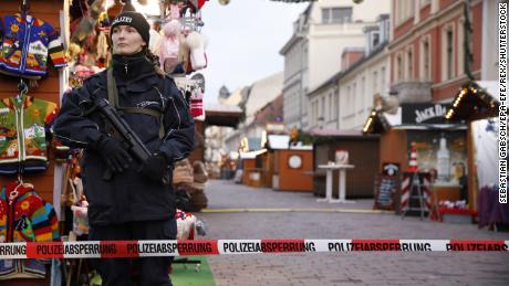 A police officer stands guard at the Potsdam Christmas market after it was evacuated.