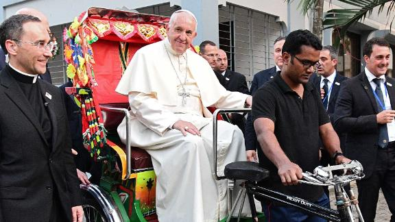 Pope Francis takes a ride in a rickshaw in Dhaka on December 1.