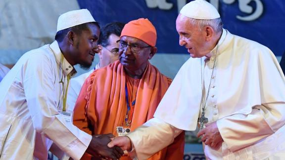 Pope Francis shakes hands with Rohingya refugees during an interreligious and ecumenical meeting for peace on Friday in Dhaka, Bangladesh.