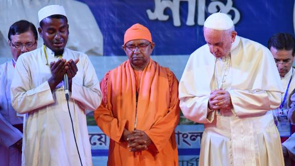 Pope Francis prays with Rohingya refugees during an interfaith peace meeting in the garden of the Archbishop of Dhaka's residence in Bangladesh's capital on Friday, December 1. Francis visited Myanmar and Bangladesh this week, meeting with leaders in both countries to discuss the Rohingya crisis. He referred to Myanmar's persecuted Rohingya Muslim minority by name Friday for the first time during his Asia tour.