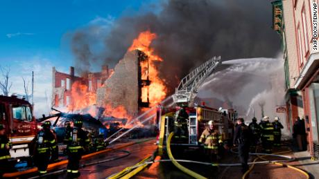 Firefighters battle a multi-alarm fire on Remsen Street on Thursday in Cohoes.