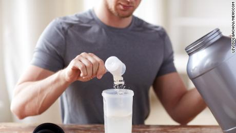 sport, fitness, healthy lifestyle and people concept - close up of man with jar and bottle preparing protein shake (Newscom TagID: ipurestockxthree992786.jpg) [Photo via Newscom]