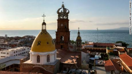 View of Church of Our Lady of Guadalupe in front of the beach of Puerto Vallarta, Jalisco state, Mexico on November 5, 2017.  Around five million tourists visit Puerto Vallarta every year.  / AFP PHOTO / DANIEL SLIM        (Photo credit should read DANIEL SLIM/AFP/Getty Images)